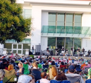 People enjoy the music during a Concerts in the Park event in this file photo. This summer's series begins June 3 with concerts planned each Monday for 11 weeks on the Huntsville Museum of Art outdoor stage in Big Spring International Park. (File photo)